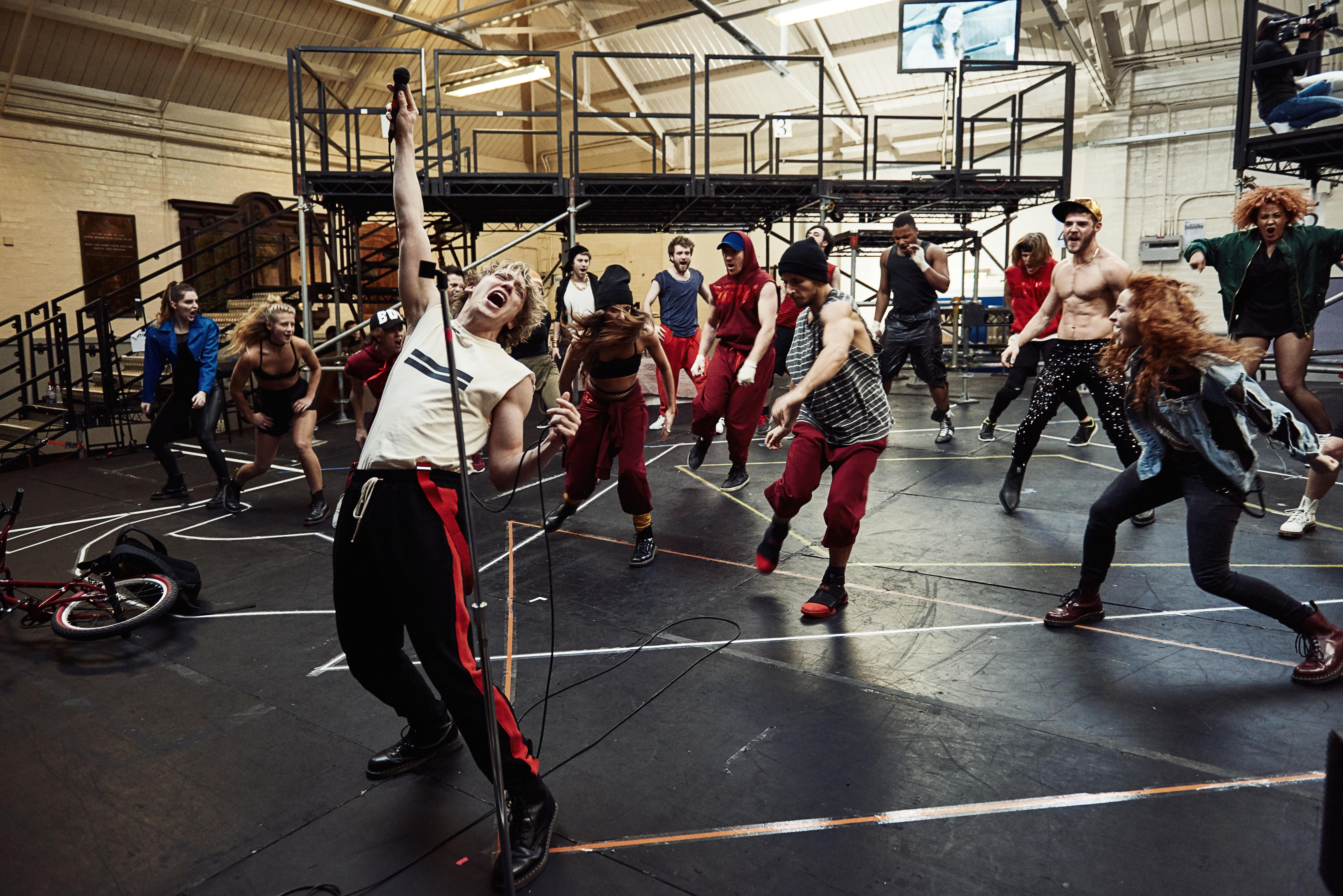 andrew-polec-and-the-cast-in-rehearsals-for-bat-out-of-hell-the-musical-credit-specular